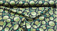 Cotton Flannel Baby Yoda Mandalorian Navy fabric - Cotton flannel fabric licensed with drawings of the character The Child (Baby Yoda) from the Star Wars The Mandalorian series from the Disney + platform, on a dark navy background with green frogs. The fa