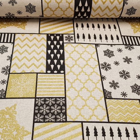 Tablecloth Christmas Golden Ice Flakes fabric - Christmas tablecloth fabric with drawings of ice flakes, stripes, trees in different pictures. The golden and black color predominates and has a glow effect in the shades of the golden color. The fabric is 1