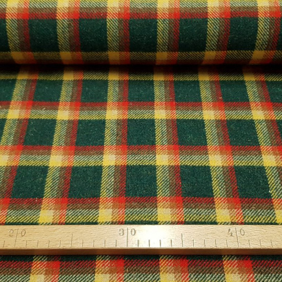 Wool Plaid Scottish Green Red Yellow fabric - Wool fabric with scottish plaid pattern in green, yellow and red tones. Ideal for making coats and other winter clothes. The fabric is 150cm wide and its composition is 100% wool.
