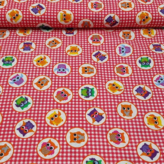 Cotton Owls Squares fabric - Beautiful and fun cotton fabric with drawings of colored owls in white circles on a background of red vichy squares. The fabric is 150cm wide and its composition 100% cotton.