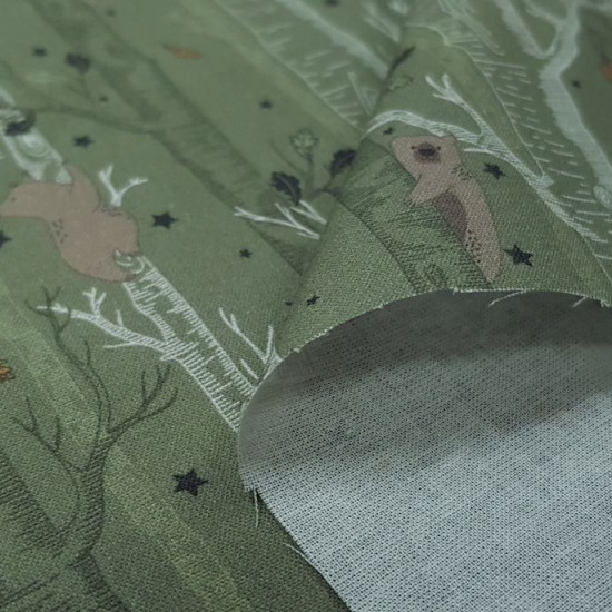 Cotton Autumn Trees Leaves Stars fabric - Organic cotton fabric with drawings of trees with bears on the branches, where you can see leaves and stars falling from the trees. The fabric is 150cm wide and its composition is 100% cotton.