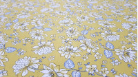 Cotton White Flowers Yellow Background fabric - Beautiful cotton fabric with drawings of white flowers on a mustard yellow background. The details of the stem are in greyish blue. Ideal fabric for clothing and creations Patchwork and dresses with floral t