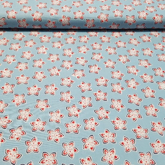 Cotton White Leaves Blue Background fabric - Cotton fabric with drawings of white and red leaves on a light blue background. This fabric is 100% Cotton and double width, ideal for Patchwork creations.