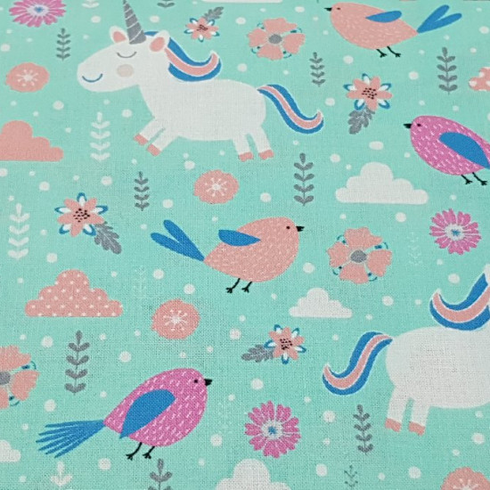 Cotton Unicorns Sparrows fabric - Lovely cotton fabric with drawings of unicorns, sparrows, clouds, plants and moles on a mint green background. This cotton fabric is ideal for children's decoration and other accessories and clothing. The fabric is 1