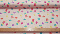Cotton Tea Party Macaroons fabric - Cotton fabric with drawings of macaroons and colorful confetti on a light background. The fabric is 110cm wide and its composition is 100% cotton.