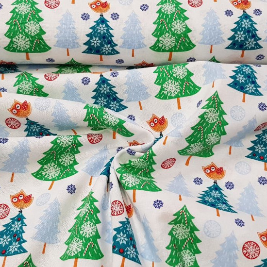 Cotton Christmas Fir Trees Owls fabric - Christmas cotton fabric with drawings of decorated fir trees and owls on top on a white background with snowflakes. The fabric is 110cm wide and its composition 100% cotton