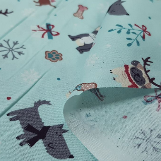 Cotton Christmas Dog Gifts Blue fabric - Christmas cotton fabric with funny drawings of dogs with reindeer antlers, gifts, bows, bones... on a light background. The fabric is 110cm wide and its composition is 100% cotton.