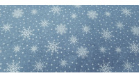 Cotton Christmas Forest Snowflakes fabric - Christmas cotton fabric with drawings of snowflakes on a background with white polka dots simulating snow. The fabric is 110cm wide and its composition is 100% cotton.