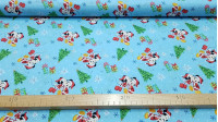 Cotton Disney Mickey Minnie Christmas fabric - Beautiful Christmas-themed Disney cotton fabric featuring Mickey and Minnie characters with Christmas trees, gifts and stars on a blue background.