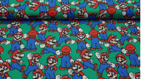 Cotton Super Mario fabric - 100% cotton license fabric with the video game character Super Mario on a green background. The fabric is 110cm wide and its composition 100% cotton