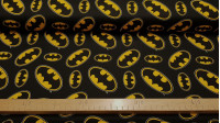 Cotton Batman Logo fabric - Cotton fabric with the legendary logo of the Batman superhero, on a black background. The logo appears in various sizes and positions. The fabric is 110cm wide and its composition 100% cotton.