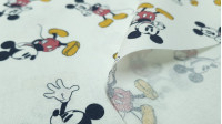 Cotton Classic Disney Mickey Poses fabric - Disney cotton poplin fabric with drawings of the character Mickey in various poses on a white background. The fabric is 150cm wide and its composition 100% cotton.