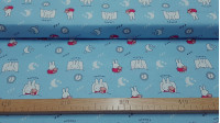Cotton Miffy Bedtime fabric - Licensed children's cotton fabric featuring the Miffy bunny on a blue background with moons, alarm clocks, stars, and the Miffy bunny sleeping in bed. The fabric is 110cm wide and its composition is 100% cotton.