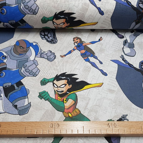 Cotton Teen Titans fabric - Large deco cotton fabric with pictures of DC Comics Teen Titans cartoon characters. The characters Robin, Raven, Starfire, Cyborg and Beast Boy appear on a light background. The fabric is 140cm wide and its compositi