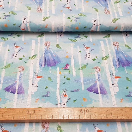 Disney Cotton Frozen 2 Trees fabric - Disney licensed cotton fabric with drawings of the characters from the movie Frozen 2 where Elsa, Olaff and Bruni the salamander appear, in a forest with trees and leaves in the wind, where green and blue colors predo