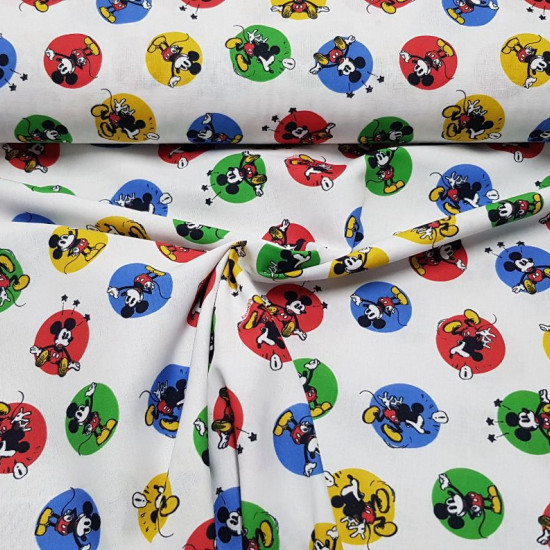 Cotton Disney Mickey Classic Circles fabric - Licensed Disney cotton fabric with drawings of the classic Mickey character in bold colorful circles on a white background. The fabric is 150cm wide and its composition is 100% cotton.