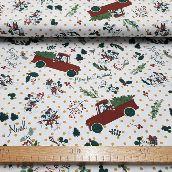 Cotton Disney Christmas Branches fabric - Beautiful Christmas-themed Disney-licensed cotton fabric featuring Mickey and Minnie wearing a scarf, silhouettes of Mickey's face and ears, and green and gold twig patterns. The fabric is 150cm wide and its compo