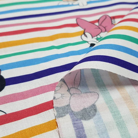 Cotton Disney Minnie Looks Rainbow fabric - Disney licensed cotton fabric with drawings of the character Minnie looming over wide striped rainbows where pink bows also appear. The fabric is 150cm wide and its composition is 100% cotton.