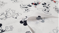 Cotton Disney Mickey Minnie Classic fabric - Disney licensed cotton fabric with classic drawings of the characters Mickey and Minnie on a white background. The fabric is 140cm wide and its composition is 100% cotton.