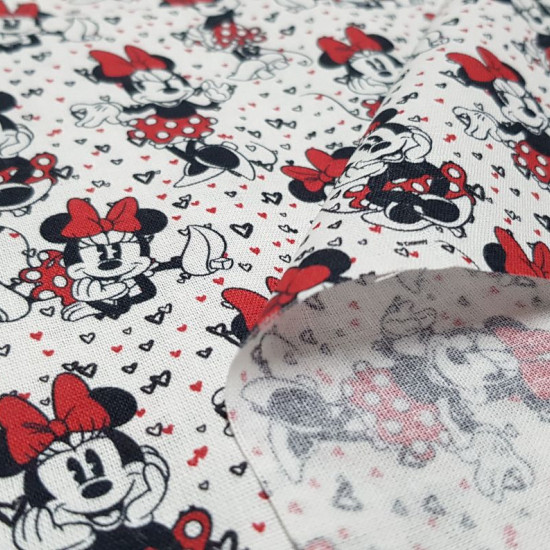 Cotton Disney Minnie Classic Hearts fabric - Disney licensed cotton fabric with classic drawings of the character Minnie where the color red predominates, and a background with tiny hearts. The fabric is 140cm wide and its composition is 100% cotton.