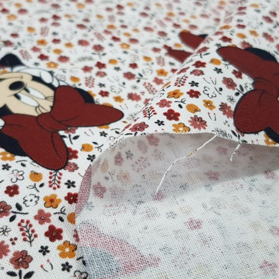 Cotton Disney Minnie Flowers White fabric - Disney licensed children's cotton fabric with drawings of the Minnie character on a flowered background where white is predominant. The fabric is 140cm wide and its composition is 100% cotton.