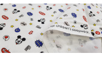 Cotton Disney Mickey Hey White fabric - Disney licensed cotton fabric with drawings of Mickey faces winking on a white background with stars, onomatopoeia and other symbols. The fabric is 110cm wide and its composition is 100% cotton.