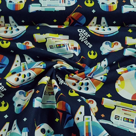 "Cotton Star Wars Rainbow fabric - Cotton licensed fabric with Star Wars drawings in a ""rainbow"" style where the Millennium Falcon, R2-D2, BB-8, the Mandalorian helmets and the imperial army appear… on a navy blue background. The fabric is 110cm wide"
