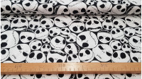 Cotton Disney Jack Skelleton fabric - Cotton fabric ideal for Halloween, with drawings of faces of Jack Skelleton, one of the protagonists of the movie Nightmare before Christmas.