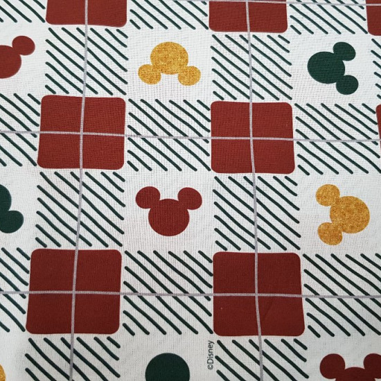Cotton Disney Christmas Mickey Ears fabric - Disney Christmas cotton fabric with Mickey silhouette drawings in green, gold and red with red and black stripe patterns.