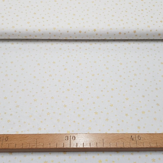 Cotton Gold Shiny Stars fabric - Cotton poplin fabric with bright gold stars pattern on white background. This fabric is ideal for Christmas-themed decorations, for example. The fabric is 150cm wide and its composition 100% cotton.