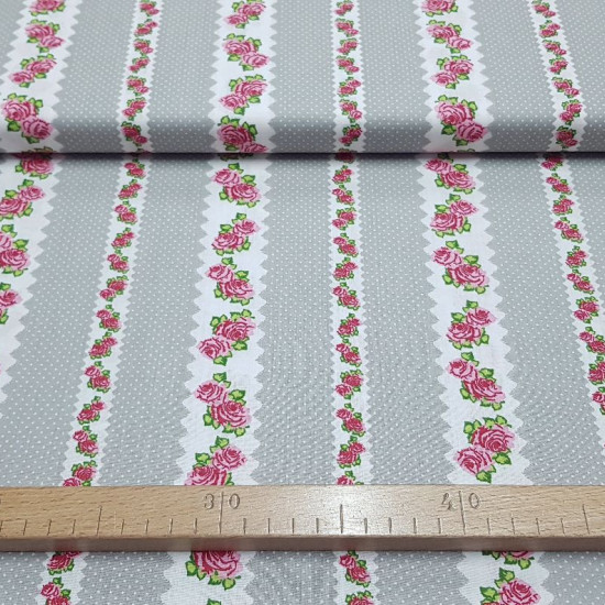 Cotton Roses and Polka Dots Gray fabric - Cotton fabric with drawings of white borders with roses and white polka dots on a gray background. The fabric is 140cm wide and its composition is 100% cotton.