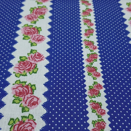 Cotton Roses and Polka Dots Blue fabric - Cotton fabric with border patterns with roses and white polka dots on a blue background. The fabric is 140cm wide and its composition is 100% cotton.
