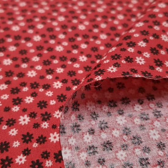 Cotton Flowers Daisies Red fabric - Cotton fabric with drawings of flowers in the shape of a daisy in black and white colors on a red background. The fabric is 140cm wide and its composition is 100% cotton.