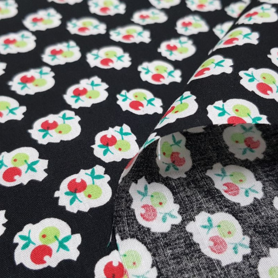 Cotton Fruit Shapes Black fabric - Cotton fabric with drawings of fruit shapes in red and green colors on a black background. The fabric is 140cm wide and its composition is 100% cotton.
