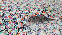 Cotton Flowers Colors Black fabric - Cotton fabric in which there are drawings of flowers of various colors on a black background The fabric is 140cm wide and its composition is 100% cotton