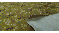 Cotton Autumn Flowers fabric - Organic cotton fabric with colorful flower drawings that remind us of autumn. The fabric is 150cm wide and its composition is 100% cotton.