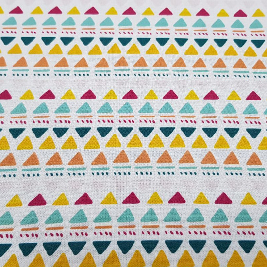 Cotton Tropical Triangles fabric - Organic cotton fabric with drawings of colored triangles and other strokes in tropical colors on a white background. The fabric is 150cm wide and its composition is 100% cotton.