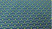 Cotton Mosaic Ornamental Bows fabric - Cotton poplin fabric with drawings of arches making a mosaic with geometric shapes where a blue background predominates. The fabric is 150cm wide and its composition is 100% cotton.