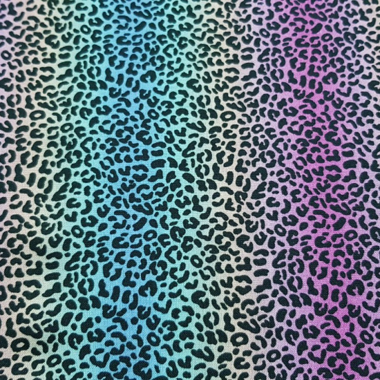Cotton Animal Print Rainbow fabric - Cotton fabric with an animal print pattern with a multicolored rainbow effect. The fabric is 150cm wide and its composition is 100% cotton.