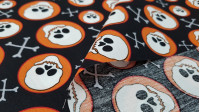 Cotton Skulls Circles fabric - Cotton fabric with skulls in orange circles on a black background.
