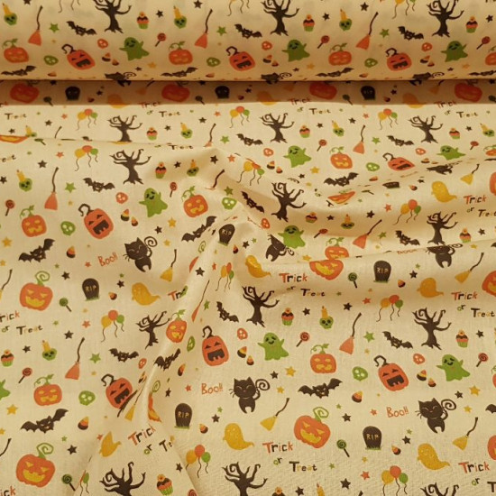 Cotton Halloween Trick or Treat fabric - Cotton fabric with a Halloween-themed digital print featuring drawings of black cats, pumpkins, terrifying trees, bats... on a light background. The fabric is 140cm wide and its composition is 100% cotton.