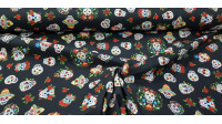 Cotton Skulls Mexican Colors Black Background fabric - Cotton fabric with drawings of Mexican skulls with lots of color on a black background. The fabric is 140cm wide and its composition 100% cotton.