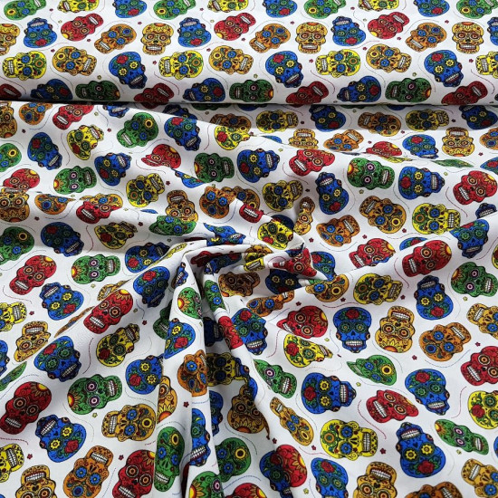Cotton Skulls Mexican Colors White Background fabric - Cotton fabric with drawings of small Mexican skulls with lots of color on a white background. The fabric is 140cm wide and its composition 100% cotton.
