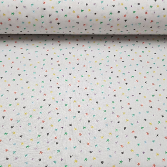 Cotton Stars Asterisks Colors fabric - Poplin cotton fabric with star patterns in different colors asterisk on a white background. Fabric made in Spain. The fabric is 150cm wide and its composition is 100% cotton.