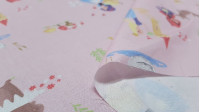 Cotton Childrens Tales Pink fabric - Poplin cotton fabric with drawings of classic children's stories such as the little red riding hood, rapuntzel, snow white... all on a light pink background. Fabric made in Spain. The fabric is 150cm wide and its com