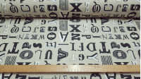 Cotton Large Letters Beige Background fabric - Cotton fabric with drawings of large corporeal black letters on a beige background. The fabric is 160cm wide and its composition is 100% cotton.