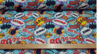 Cotton Comic Onomatopoeia Blue fabric - Digital printing cotton fabric with drawings of bullets and onomatopoeia from comics. A very striking and colorful design. The fabric is 140cm wide and its composition is 100% cotton.