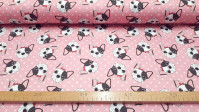 Cotton Pink Bulldog Smiley fabric - Digital printing satin cotton fabric with drawings of bulldog dog faces on a pink background with light spots. The fabric is 140cm wide and its composition is 100% cotton.