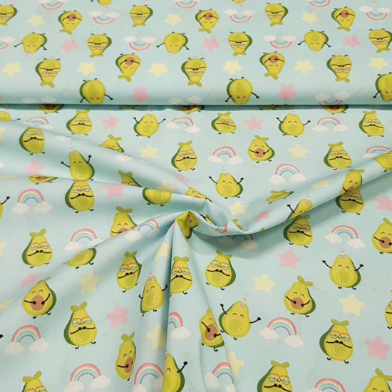Cotton Avocados Funny Rainbow fabric - Very fun digital print cotton fabric with avocado drawings with colorful glasses on a light blue background of stars and rainbows. The fabric is 140cm wide and its composition is 100% cotton.