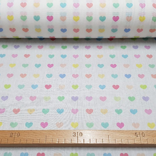 Cotton Hearts Colors fabric - Cotton fabric digital printing with drawings of soft colored hearts on a white background. The fabric is 140cm wide and its composition is 100% cotton.